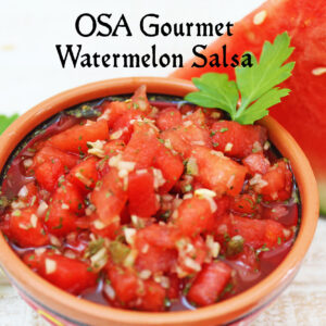 bowl of watermelon salsa with slice of watermelon