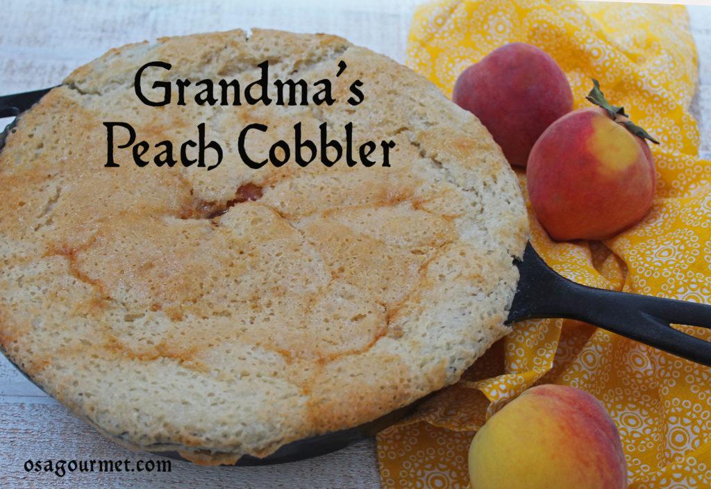 Grandma's Peach Cobblerr in a skillet with fresh peaches