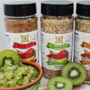 kiwi salsa with bottles of Delectable Datil Salsa Seasoning