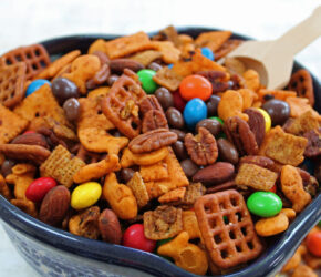 bowl of trail mix with wooden scoop