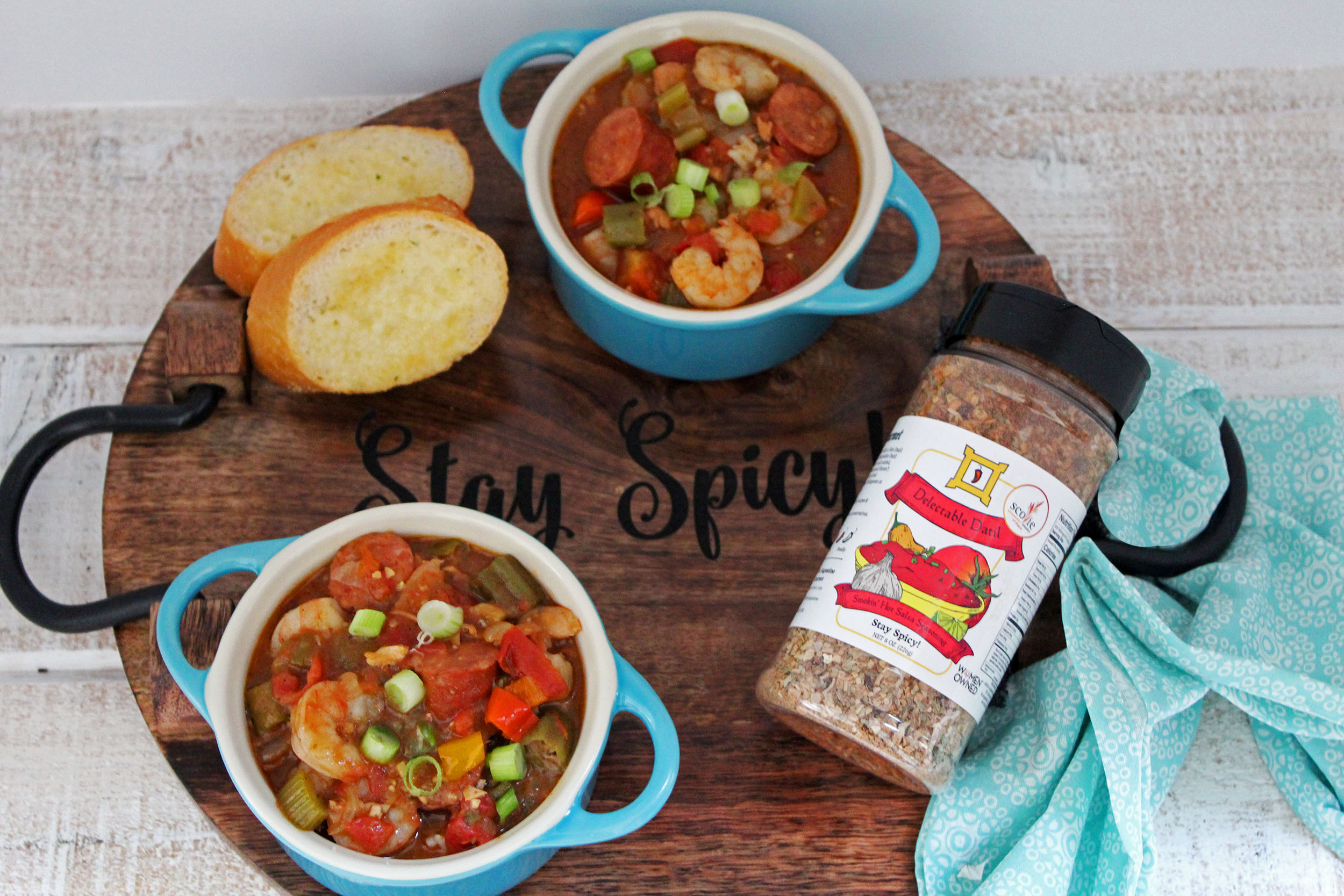shrimp and sausage gumbo in blue bowls with French bread and Delectable Datil Salsa Seasoning